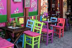 Terrasse multicolore (Lucille-bs) Tags: europe grèce greece crète creta kriti lacanée chania hania khania terrasse terrassedecafé chaise couleur multicolore table café bar