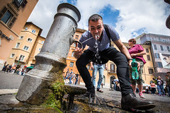 Drinking vigorously in Rome, Italy (Catherine Gidzinska and Simon Gidzinski/grainconno) Tags: 2016 europe may rome crowd drinking italy man moss plaza portrait spring tourist vatican water waterfountain wideangle