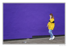 Yellow and Purple (Seven_Wishes) Tags: newcastleupontyne jo outdoor photoborder city street canoneos5dmarkiv canonef24105mmf4lisii streetphotography candid woman redhead mobilephone yellow purple young walking pretty slim jeans wall purplewall student people