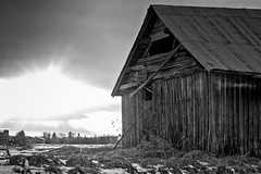 Springtime Sunset Behind An Old Barn House (k009034) Tags: 500px sky sunset nature clouds old architecture building black white snow fields countryside agriculture barn rural wooden springtime no people finland tranquil scene copy space oulainen matkaniva teamcanon