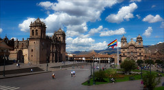 Cusco Main Square (kate willmer) Tags: cathedral square sky clouds building architecture people city flag church cusco peru