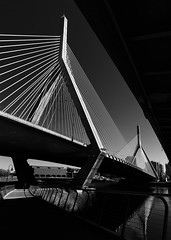 Zakim Bridge (trochford) Tags: zakimbridge cablestayed bridge highway i93 river water reflection charlesriver walkway footbridge northpointpark leverettconnector sunny sunlight light shadow angles design architecture black white contrast highcontrast dramatic cambridge cambridgema cambridgemassachusetts boston bostonma bostonmassachusetts ma massachusetts newengland usa bw bnw blackandwhite blackwhite noiretblanc blancoynegro mono monochrome canon outdoor exterior