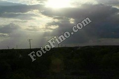 Sun Shining Through Clouds (FotoFino.stock.photos) Tags: cool clouds nature blue sky cloudy sun shining shiny shine bright light landscapes landscape