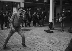Random dancer (weave193) Tags: dancer busker guitar manchester street performer cobbles crowd bw