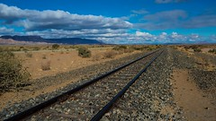 Train to nowhere (marcomariamarcolini) Tags: valley marcomariamarcolini nikond800 d800 nikkor2470f28 namibia mountains landscape clouds colors wow road digital blue blu panoramic berge landschaft wolken farben strase blau panorama nuvole montagne paesaggio colori stradale digitale panoramica vallée namibie montagnes paysage nuages couleurs route numérique panoramique sky cielo ciel train railway chemindefer binario binari africa depthoffield rural naturaleza