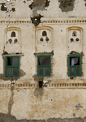 Front Of An Old House, Mocha, Yemen (Eric Lafforgue Photography) Tags: history coffee vertical architecture facade outside construction asia day hole outdoor empty middleeast nobody nopeople architectural mocha arabia housing historical daytime yemen ottoman preserved technique moca functional turkish moka preservation mocca craftsmanship colorphoto mukha mokka dayview greenwindow bluearrow colorpicture placeofinterest mokha woodenwindow arabiafelix arabianpeninsula thickwall colourpicture almokha almukha redseacoastofyemen localmaterial buildingskill flatearthroof blissfularabia harmoniousarchitecture