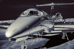 Phenom 100 (PGHAERIALS) Tags: flying blackwhite artistic aviation jets phenom embraer bizjets vlj avphotographicscom lightjets
