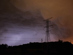 Titans in the Storm (Scallywag Photography) Tags: blue sky white storm black tower rain silhouette electric night clouds danger dark dangerous nikon purple bright wind flash echo wires bow bolt electricity lightning d90
