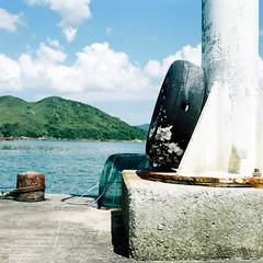 Tire and pier (Szto) Tags: tlr film mediumformat landscape bay pier minolta fujicolor autocord 75mmf35 pro160ns