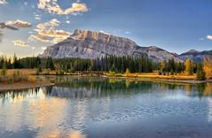 Banff Bounty (Phil's Pixels) Tags: bridge autumn canada sunrise reflections dawn alberta banff daybreak mtrundle cascadepond