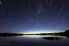 Michigan Stars (Rick Sause Photography) Tags: blue trees light shadow sky sun lake black reflection yellow night mi forest sunrise reeds stars photography star photo pond long exposure shadows time great north trails stack trail nighttime mclaren hesperia wilderness rise hint stacks startrails stax startrail sause