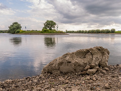 Large rock by quiet river in Doesburg, Holland (frank.hoekzema) Tags: holland color reflection tree green nature water colors rock stone clouds reflections river landscape stream riverside scenic rocky peaceful boulder journey shore plain tranquil cloudscape concepts