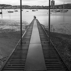 On the Jetty (the underlord) Tags: family wales square three fishing anniversary jetty cymru cropped conwy northwales 500x500 bsquare silverefexpro2 fujixpro1 xf18mmf2r