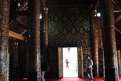Interior of Wat Xieng Thong, taken on the way out (oldandsolo) Tags: southeastasia buddhism tourist lp laos wat buddhisttemple luangprabang chedi watxiengthong buddhistart buddhistshrine laopdr buddhistarchitecture unescoworldheritagecity buddhistreligion touristphotographers buddhistfaith