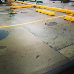Glad this is the last time I'll be doing this drive for a while! #Virginia #rain (newlightbulbs) Tags: travel lines rain yellow square concrete virginia moving parkinglot driving parking lot gasstation squareformat unknown iphoneography instagramapp uploaded:by=instagram