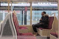 in transit (Ian Muttoo) Tags: img20170331115654shiftnedit ontario canada gimp toronto shiftn streetcar ttc torontotransitcommission woman street candid streetstyle