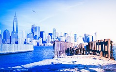 Manhattan skyline from storm damaged jetty by New Jersey Railroad Terminal DSC_3511 (Trip choc) Tags: newjersey newyork libertystatepark hurricanesandy manhattan blue hudsonriver pier jetty