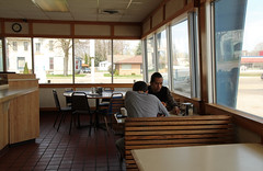 Diners in a Doughnut Shop (Pythaglio) Tags: dutch uncle donuts doughnuts doughnut donut shop store people humanbeingsforonce coldwater michigan branch county interior empty tables benches chairs tile floor counter windows clock diners dining eating delicious