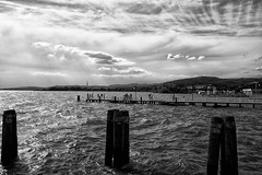 After the heavy weather ./ Na de storm (jo.misere) Tags: bw zw lago trasimeno umbrie clouds wolken water pier