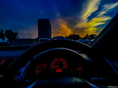 Drive through the clouds (Mohsan Raza Ali Baloch) Tags: iphone sunset vehicle evening golden hour clouds dramatic drama sky signal light low high iso honda meter dashboard streeing red yellow blue odometer rpm mohsans mohsan