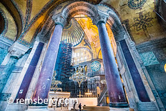 Interior columns of the Hagia Sophia located in Istanbul, Turkey. (Remsberg Photos) Tags: istanbul turkey hagiasophia column columns purple colorful chandelier light design ornate painting calligraphy islamic ceiling interior blue tones religious space construction tur