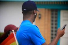 Bokeh man in parade (LarryJay99 ) Tags: male pridefest man dude nape lakeworth dudes guys blue hairyman hairyarms canon60d guy handsomepeople facialhair cape unsuspecting florida streets prideparade smartphone men arms face bokeh people steps canonefs18135mmf3556is