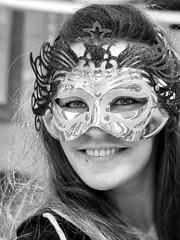 Findlay Market Mardi Gras Celebrant (J Wells S) Tags: candidportrait portrait blackandwhite bw monochrome findlaymarket mardigras cincinnati ohio woman costume party overtherhine otr mask smile teeth