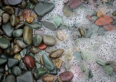 Stones & Bubbles (Karen_Chappell) Tags: beach bubbles rocks stones pebbles nature macro ocean sea coast nfld newfoundland middlecove middlecovebeach avalonpeninsula canada atlanticcanada atlantic colour multicoloured surf water