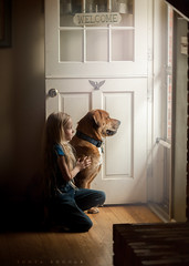 Waiting (Sonya Adcock Photography) Tags: girl child kid photography childphotography light evening glow warm family painterly portrait ray poetry poetic story nikon nikond700 nikkor nikkor105mmdc childhood fineart fineartphotography art sonyaadcockphotography dog door doorway animal animals