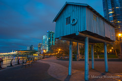 Light Shed (Moe W) Tags: city sunset canada art public night vancouver clouds bench aluminum bc waterfront pacific harbour path walk seawall condo installation publicart canadaplace coalharbour conventioncentre lightshed lizmagor mauricewoodworth