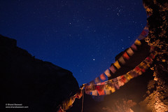 Under the blanket of stars, on the blanket of ice. (Bharat Baswani) Tags: blue winter snow ice night trek stars fire prayer flags astro zanskar ladakh chadar
