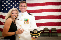 Naval Officer Retirement (.James Brian Clark) Tags: family portrait people woman usa man male love home smiling female standing soldier happy person hugging holding war couple uniform married affection flag military husband spouse pride relationship together hero wife hispanic veteran twopeople affectionate armedforces caucasian embracing zlq12 zlq13