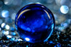 Blue Marble on Glitter (lensletter) Tags: blue abstract glass glitter canon catchycolors 1 shiny crystal bokeh orb sphere marbles marble dslr shimmer canondslrusergroup canondslrgroup maxfudge awardtree amazingmacrosgroup exoticimage bubbleballisious lensletter