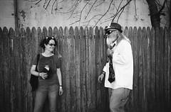 (Josh Sinn) Tags: street blackandwhite bw woman man film beer festival 35mm fence md kodak trix tie maryland fair baltimore neighborhood 400 sowebo sowebofest nikonnikkormatftn joshsinn