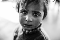 Lost and lonely (Giulio Magnifico) Tags: life woman black eye girl closeup composition contrast turkey dark intense eyes war alone shadows child sad emotion expression refugee refugees young streetphotography streetportrait sharp desperate help silence surprise confused syria essence curious gaze curiosity glance genuine kilis nikond800e sigma35mmf14dghsm