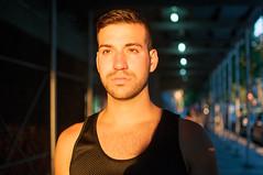 Constructed (Stephanie Wesolowski) Tags: street nyc gay summer portrait urban sunlight newyork male face 35mm model nikon photographer mesh bokeh manhattan editorial magichour scruff d300s