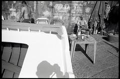 (Whole Package) (Robbie McIntosh) Tags: leicamp leica mp rangefinder streetphotography 35mm film pellicola analog analogue negative leicam analogico blackandwhite bw biancoenero bn monochrome argentique autaut dyi selfdeveloped filmisnotdead kodaktrix kodak trix 400 ilfordilfotecddx ddx strangers elmarit leicaelmarit28mmf28iii elmarit28mmf28iii 28mm men beach onthebeach belly sleep tattoo yoyo shadow package