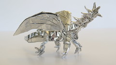 Box-pleated origami dragon - version three (Tankoda) Tags: origami box pleated boxpleated dragon evolution version one 1 travis nolan own design folded by art paper japanese foil 6 six inch 8 eight gold silver wings head legs toes body transition tail horns greatness ville