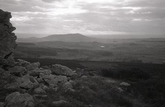 . (OhDark30) Tags: olympus 35rc 35 rc film 35mm monochrome bw blackandwhite bwfp fomapan 200 rodinal landscape hills dark stiperstones shropshire corndonhill rocks outcrop clouds sky wales welshmarches fields forests view