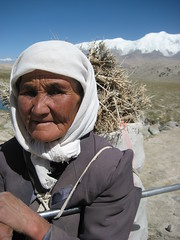 Kyrgyz Woman Gathering Cooking Fuel Xinjiang Uyghur Autonomous Region China (eriagn) Tags: endurance editorial social people firewood carrying load silkroad trade traderoute uyghur ethnic minority dailylife xinjiangautonomousregion ngairehart photography xinjianguyghurautonomousregion karakoramhighway kkh weathered face portrait woman kyrgyz tajik snow mountain highaltitude autumn cold blue