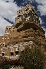 IMG_0106 copy (mariatarasoff) Tags: yemen sanaa architecture adobe brick ancient old decorative unheritagesite un streets facade mud red white primitive arab arabia arabian countryside landscapes relief brown window arch archway stone traditional sky blue patterns clouds yemeni