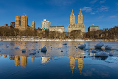 Frozen Reflections (Amar Raavi) Tags: centralpark newyorkcity nyc newyork cityscape reservoir water frozen ice buildings skyline upperwestside uws usa outdoors winter reflections manhattan jacquelinekennedyonassisreservoir lowangle