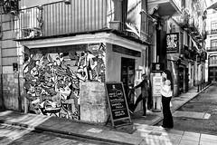 Sangría, paella, agua de Valencia... What else? (Ruben H. Pinilla) Tags: nikon d750 nikond750 tamronsp2470mmf28divcusd rubenhpinilla blackandwhite bw mono monochrome street streetphoto streetphotography candid valencia woman streetart graffiti