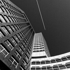 Meet the Airplane (Johan Konz) Tags: abnamro headquarters financial offices zuidas amsterdam netherlands outdoor bw blackandwhite architecture tower monochrome building symmetry lines geometric airplane sky windows pov lookup angle diagonal modern perspective shapes vertical urban