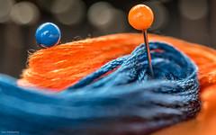 Orange And Blue (John Penberthy LRPS) Tags: 105mm d750 johnpenberthy nikon blue bokeh closeup cotton macro macromondays orange pins silk skein yarn