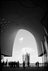 Futuristic Towers // Hamburg (//Sebastian) Tags: hamburg hafencity germany frame elbphilharmonie elphi architecture black white grey shades michel church round curves lines people tourist sight columbushaus columbus tower glass skyscraper panorama autostitch concrete view lights top platform plaza