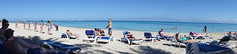 Beach Panorama (Brian 104) Tags: cuba holiday beach sand ocean sunbathers stretching reading swimming warm