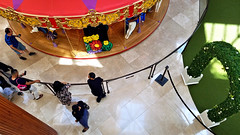 Parents at a Carousel (EmperorNorton47) Tags: southcoastplaza costamesa california photo digital winter carousel parents shoppers shoppingcenter mall