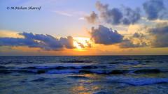 The Evening Sun (M.RISHAN SHAREEF) Tags: nature native water blue black beach cloud colombo ocean evening enjoy yellow sea thenature sky lighting light orange srilanka sun