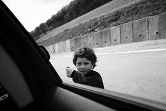 gypsy beggar (jrockar) Tags: ngc unposed portrait fromthecar people decisive instant moment candid life madness ordinary ordinarymadness idiot janrockar jrockar blackandwhite mono bw holyf fuji x100f erdély beggar child kid gypsy romania transylvania